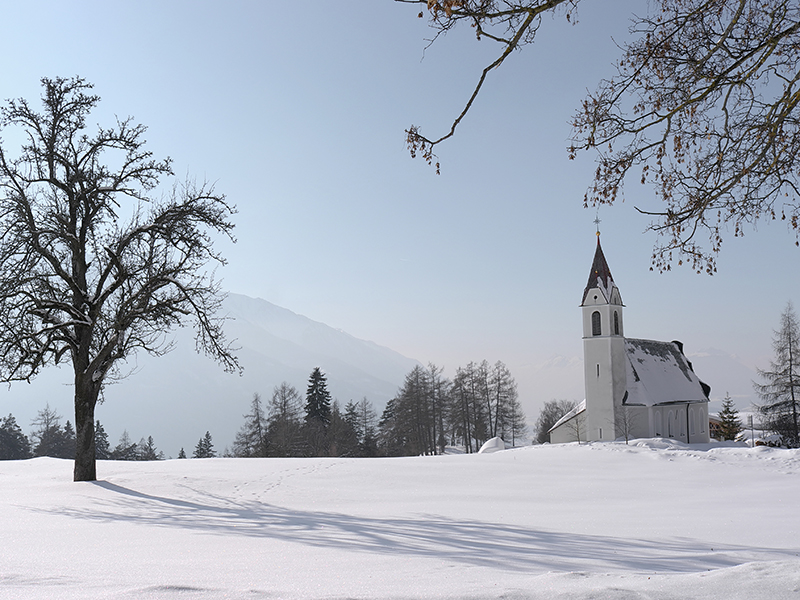 [Translate to it:] Winter – Kirche von Mösern